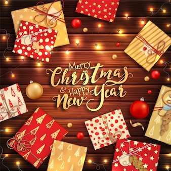 Merry christmas and happy new year background with colorful baubles, gift boxes and garlands