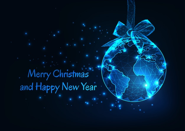 Merry christmas and happy new year greeting card with world globe as a hanging ball and ribbon bow.