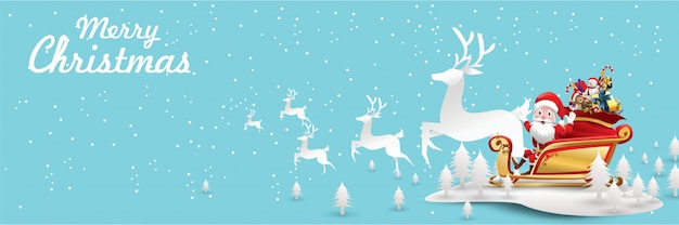 Merry christmas and happy new year. santa claus is rides reindeer sleigh paper art concept