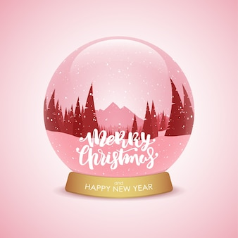 Merry christmas and happy new year. snow globe with winter mountains landscape.