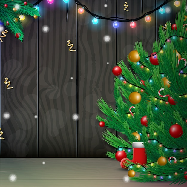 Merry christmas and happy new year with decorated christmas tree and sparkling lights garland on wood background