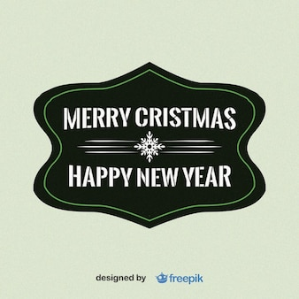Merry christmas and happy new year with snowflake in the middle label