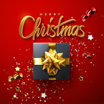 Merry christmas holiday gold lettering sign on red background with glittering confetti and gift box