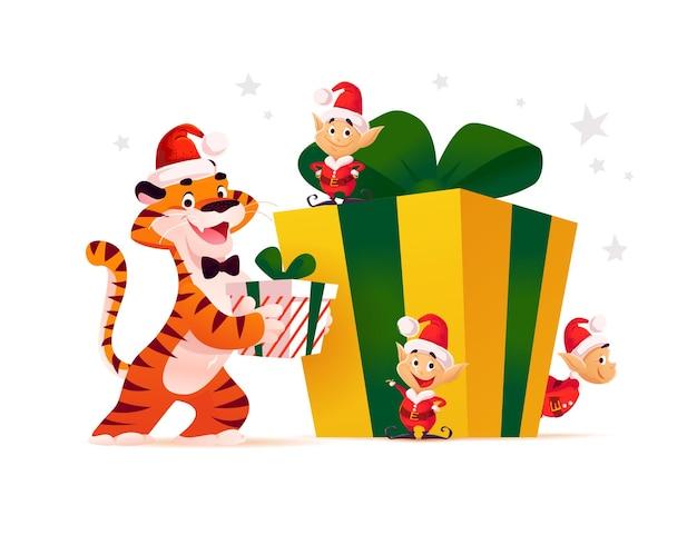 サンタの帽子をかぶったトラと大きなギフトボックスに小さなサンタのエルフが隔離されたメリークリスマスのイラスト。ベクトルフラット漫画スタイル。バナー、セールカード、ポスター、タグ、ウェブ、チラシ、広告などに。