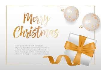 Merry Christmas lettering in frame with baubles and gift box