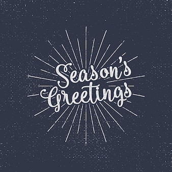 Merry christmas lettering. season's greetings. holiday typography vector. letters composition with sun bursts and halftone texture.