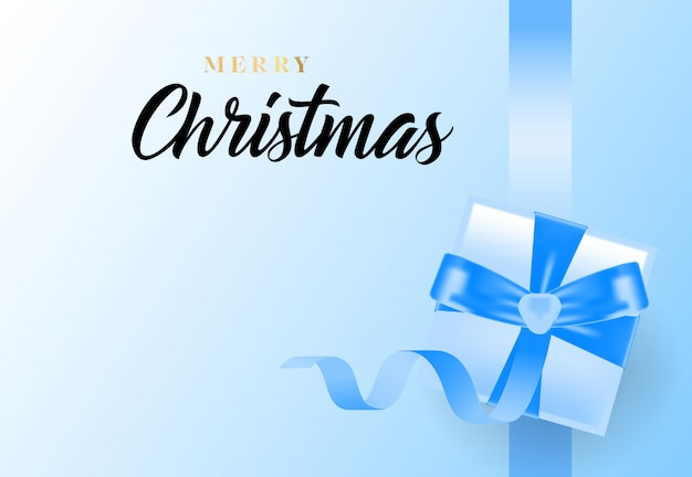Merry christmas lettering with ribbon and gift box