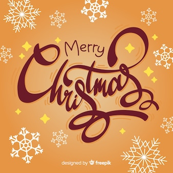 Merry christmas lettering with snowflakes
