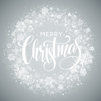 Merry christmas lettering with white snowflakes on gray gradient background