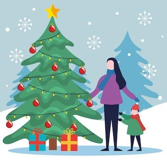 Счастливого рождества мать и дочь с сосной и подарками