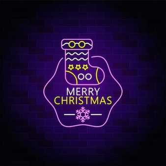 Merry christmas neon sign with christmas sock icon
