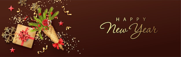 Merry christmas and new year banner with a bouquet of christmas branches in a waffle cone