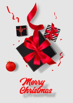 Merry christmas  poster. top view on black gift box on white background