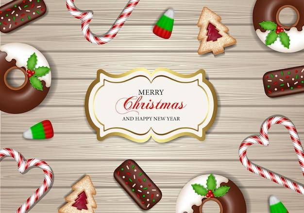 나무 배경에 과자와 함께 메리 크리스마스 포스터