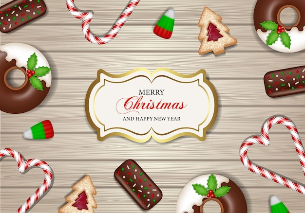 Merry christmas poster with sweets on wooden background