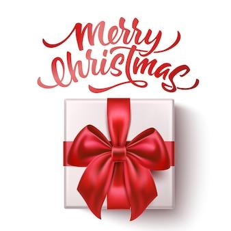 メリークリスマスの現実的な赤い蝶ネクタイと現在のボックスにシルクの赤いリボン