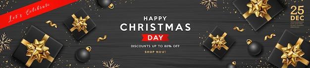メリークリスマスセールブラックギフトボックスゴールデンリボンブラックボールとスノーフレークバナーデザイン