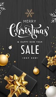 メリークリスマスセールギフトボックスゴールデンリボン白い色のコンセプトデザインの黒い木の背景