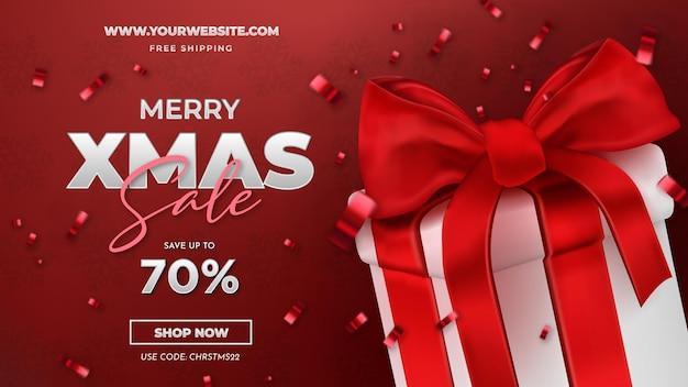 Saldi di buon natale con sfondo regalo rosso realistico