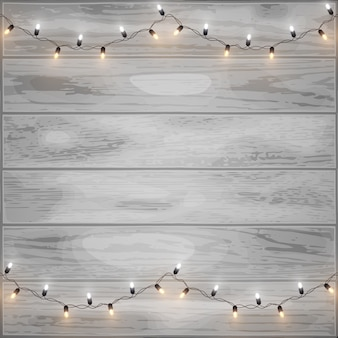 Merry christmas shiny led lights on wood background