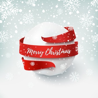 Merry christmas, snow ball with red bow and ribbon around, on winter background.