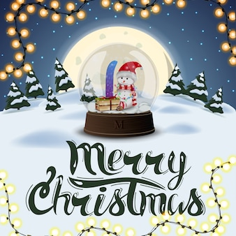 Merry christmas, square postcard with night winter landscape, full moon, pines, drifts and big snow globe with snowman
