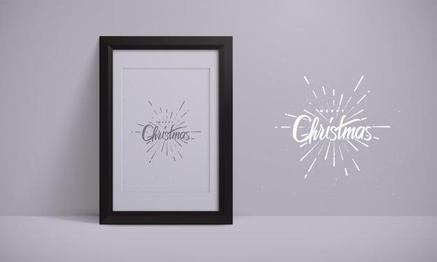 Merry christmas vintage lettering label with firework burst shape on black picture frame mock up