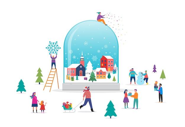 Merry christmas, winter wonderland scene in a snow globe