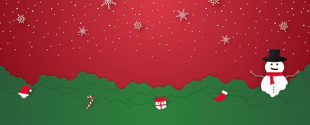 ウェルカムスノーマンとペーパーアートスタイルのものに雪が降るメリークリスマス