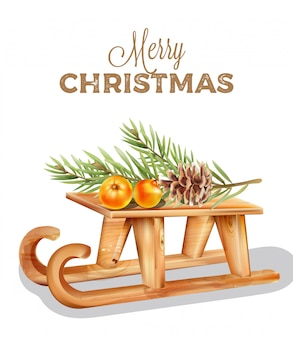 Merry christmas wooden sleigh with orange fruits on top