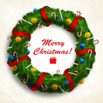 Merry christmas wreath decorated with ribbons and baubles on white