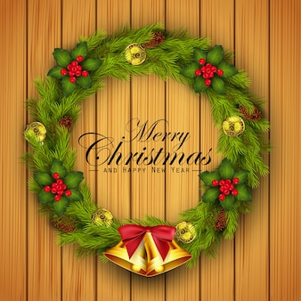 Merry christmas wreath with gold bells on wooden background