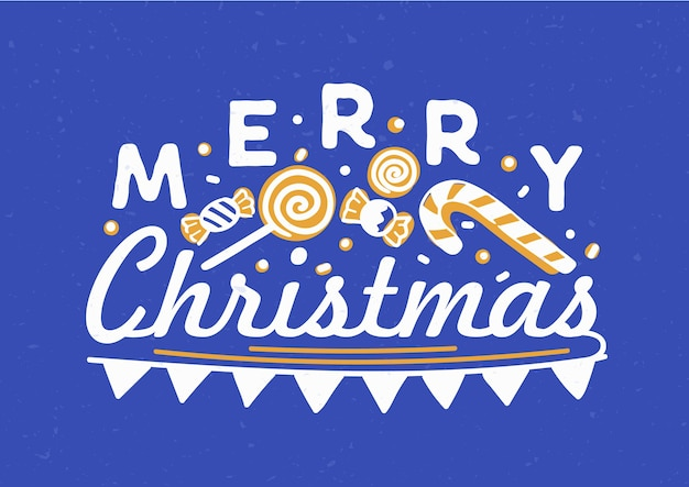 Merry christmas written with elegant cursive calligraphic font with flag garland, candies and lollipops