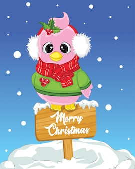 Merry chtistmas wooden sign with sitting bird