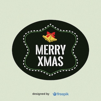 Merry xmas label with bells in the upper