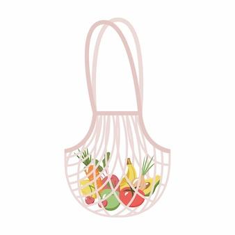 白い背景に分離された果物と野菜のメッシュまたはネットバッグ新鮮な有機バナナリンゴトマトニンジンチェリーと地元の市場からのレモンと現代の買い物客