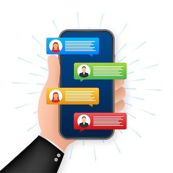 Концепция обмена сообщениями. рука смартфон с людьми в чате. текстовые пузыри чата на экране телефона.