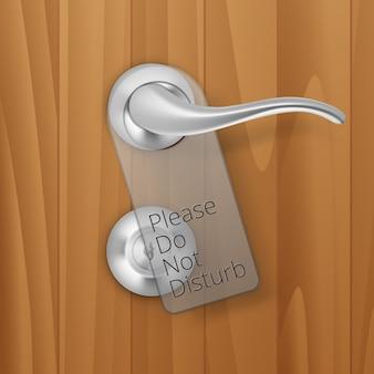 Metal door handle lock with hanger  on wood wooden background