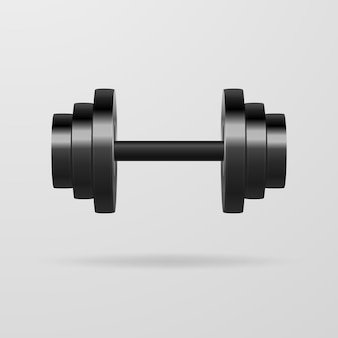 Metal dumbbells on a gray