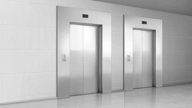 近代的なオフィスの廊下の金属製エレベーターのドア