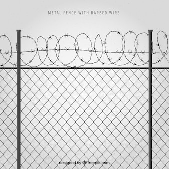 Metal fence with barbed wire on gray background