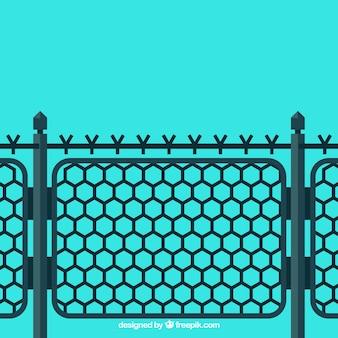 Металлический забор с колючей проволокой на синем фоне