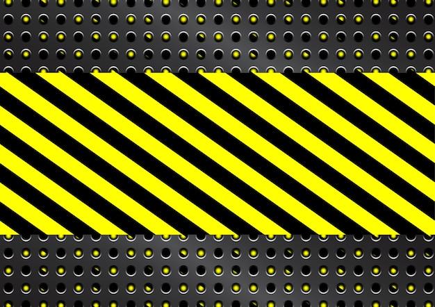 노란색과 검은 색 줄무늬가있는 금속 그리드