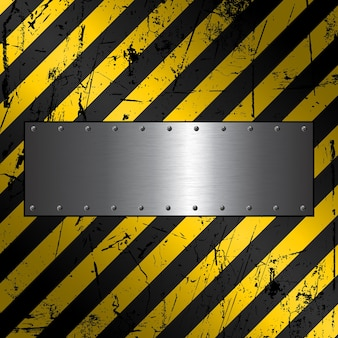 Metal plate on a textured grunge construction background