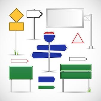Набор металлических дорожных знаков на столбах