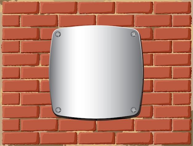 レンガの壁の金属シールド