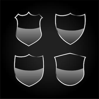 금속 검은 방패 또는 배지 아이콘 세트