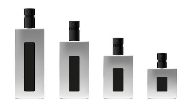 白い背景で隔離の香水のための黒いキャップスプレーで設定された金属製の小瓶