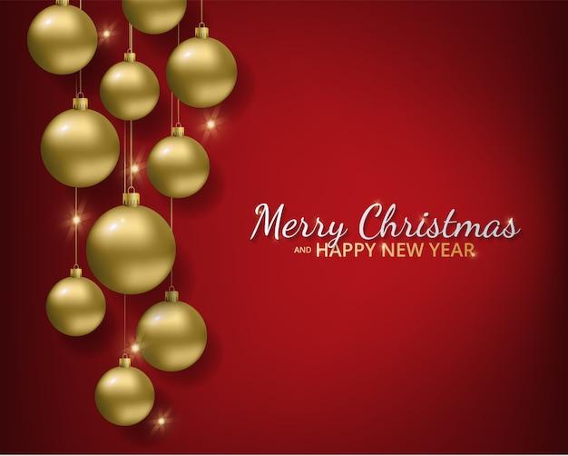 赤い背景の上の金属の赤いクリスマスボール。