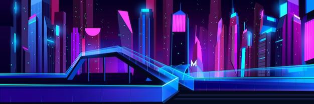 Ingresso della metropolitana nella città di notte con illuminazione al neon